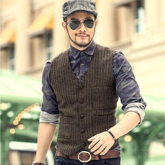 How to wear: olive wool waistcoat, navy camouflage denim shirt, black jeans, grey plaid flat cap