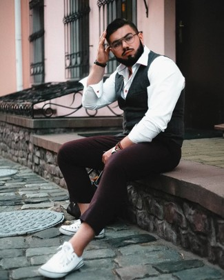 How to wear: charcoal waistcoat, white dress shirt, burgundy wool chinos, white canvas low top sneakers