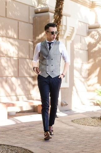 How to Wear a Black Bracelet For Men: Seriously stylish yet comfortable, this outfit combines a grey waistcoat and a black bracelet. A pair of brown leather double monks easily steps up the fashion factor of this getup.