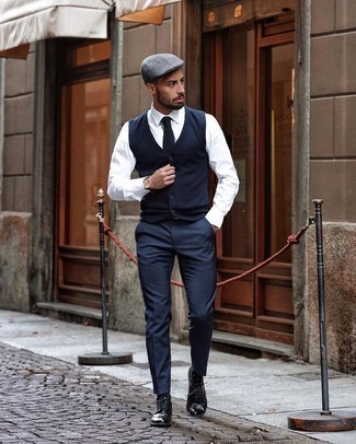 Tie Outfits For Men: Marry a navy wool waistcoat with a tie to look like a true style expert. If you want to immediately dial down this getup with one item, introduce a pair of black leather brogues to the equation.