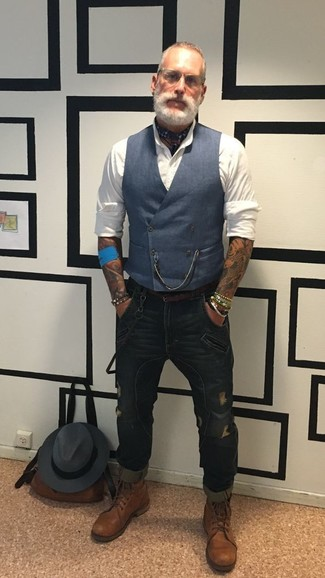 How to wear: navy waistcoat, white dress shirt, navy ripped skinny jeans, brown leather casual boots