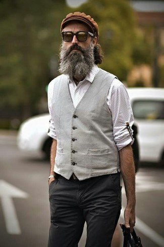 How to wear: grey waistcoat, white polka dot long sleeve shirt, charcoal chinos, brown flat cap