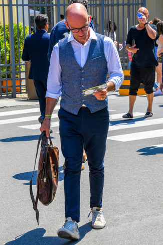 Navy Waistcoat with Navy Chinos Outfits After 50: A navy waistcoat and navy chinos married together are a great match. On the fence about how to round off? Complement your look with a pair of white leather low top sneakers for a more relaxed twist. And if we're talking fashion tips for 50-something gentlemen, this look is perfect.