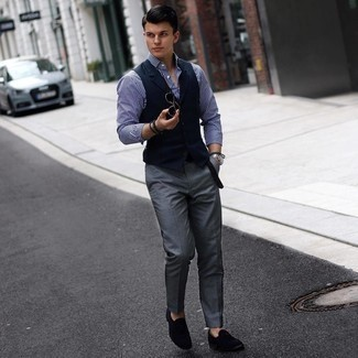 500+ Warm Weather Outfits For Men: We love the way this pairing of a navy waistcoat and charcoal chinos instantly makes men look elegant and smart. Add a pair of navy suede loafers to your outfit to pull the whole thing together.