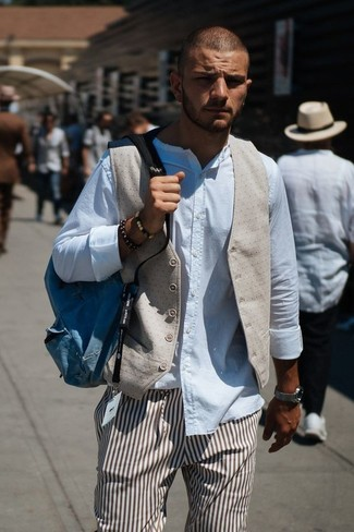 How to wear: beige waistcoat, white long sleeve shirt, brown vertical striped dress pants, blue canvas backpack