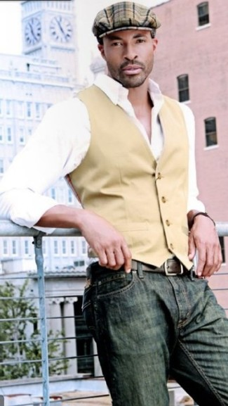 How to wear: tan waistcoat, white long sleeve shirt, olive jeans, brown plaid flat cap