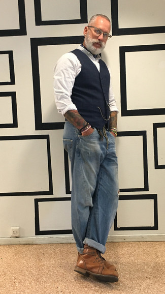 How to Wear Brown Leather Casual Boots For Men: For a look that offers functionality and dapperness, reach for a navy plaid waistcoat and blue ripped jeans. You know how to bring an added touch of refinement to this look: brown leather casual boots.