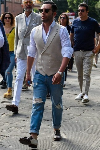 How to Wear a Beige Waistcoat: Marrying a beige waistcoat with blue ripped jeans is an on-point choice for a casually sleek look. Get a little creative on the shoe front and add dark brown leather tassel loafers to the mix.