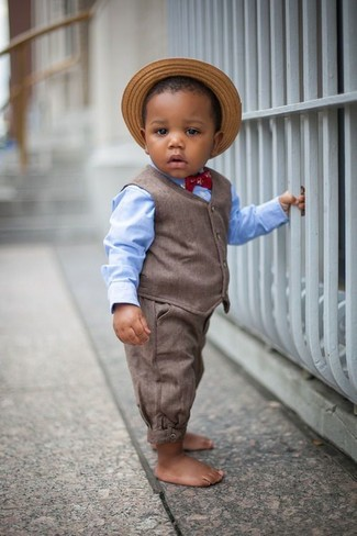 How to wear: brown waistcoat, light blue long sleeve shirt, brown trousers, tan straw hat