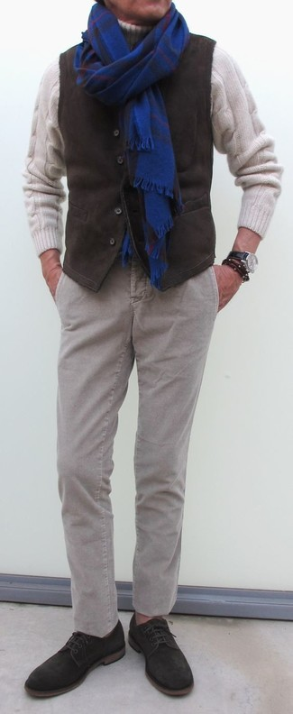How to wear: dark brown corduroy waistcoat, white knit wool turtleneck, grey corduroy chinos, dark brown suede derby shoes