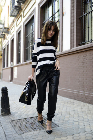 A white horizontal striped crew-neck pullover and black leather drawstring pants are a perfect combination to be utilised at the weekend. Add black leather pumps to your look for an instant style upgrade.