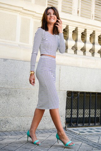 This combo of a white horizontal striped crew-neck jumper and a monochrome striped pencil skirt is a safe bet for an effortlessly cool look. Elevate this ensemble with aqua leather heeled sandals.