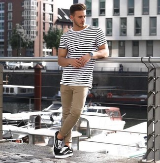 A white and black horizontal striped crew-neck t-shirt and beige chinos is a good combination to add to your styling repertoire. Complement this look with black low top sneakers.