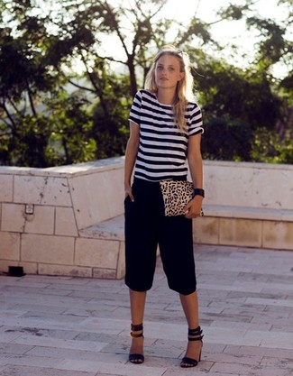 How to wear: white and black horizontal striped crew-neck t-shirt, black bermuda shorts, black suede heeled sandals, tan leopard suede clutch