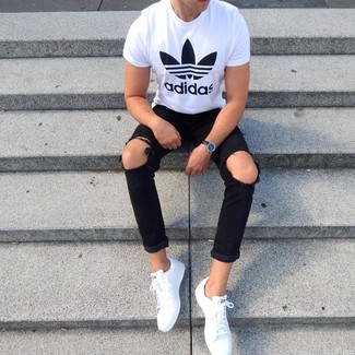How to wear: white and black print crew-neck t-shirt, black ripped skinny jeans, white leather low top sneakers, black leather watch