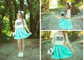 How to wear: white and black print crew-neck t-shirt, mint skater skirt, white leather lace-up ankle boots, white headband