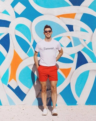 How to wear: white and black print crew-neck t-shirt, red shorts, white canvas low top sneakers, black sunglasses