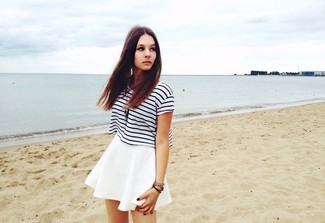 A white and black striped crew-neck t-shirt and a white skater skirt is a wonderful combination to add to your casual repertoire.