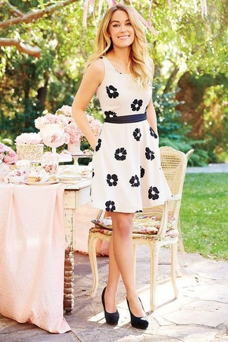 If you don't like putting too much effort into your ensembles, consider wearing a white and black floral skater dress. Elevate your outfit with black suede pumps. This combination is essentially a lesson in how to master the hot weather fashion.