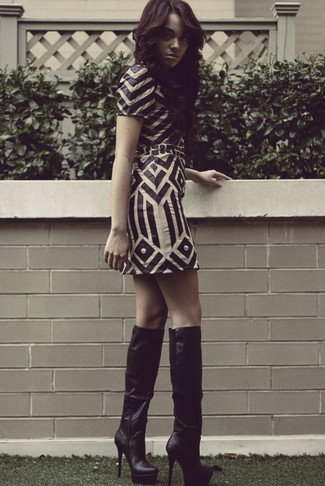 Choose a white and black geo leather sheath dress for a sleek elegant look. A pair of black leather knee high boots brings the dressed-down touch to the ensemble.