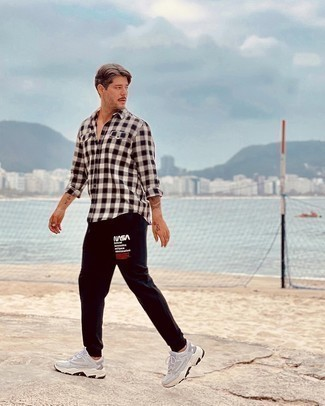Sweatpants Outfits For Men: This combination of a white and black gingham long sleeve shirt and sweatpants is very easy to recreate and so comfortable to rock a version of as well! Upgrade this getup with a pair of grey athletic shoes.