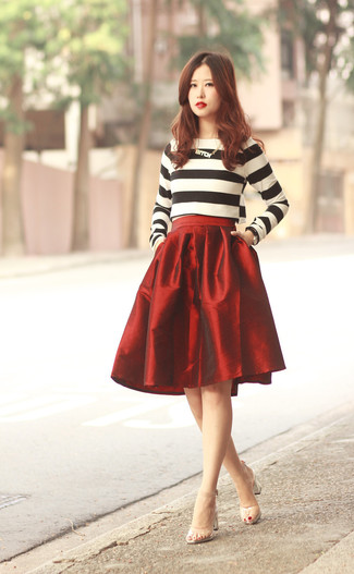 A white and black crew-neck pullover and a red full skirt is a great combination worth integrating into your wardrobe. Clear rubber heeled sandals will instantly smarten up even the laziest of looks.