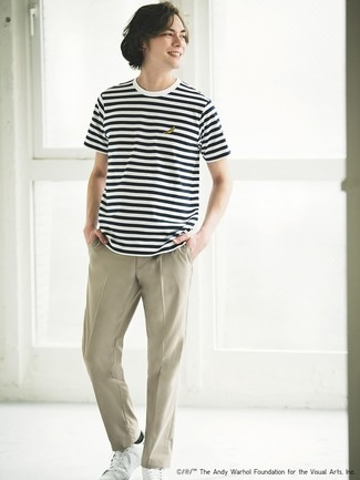 How to wear: white and black horizontal striped crew-neck t-shirt, beige chinos, white leather low top sneakers