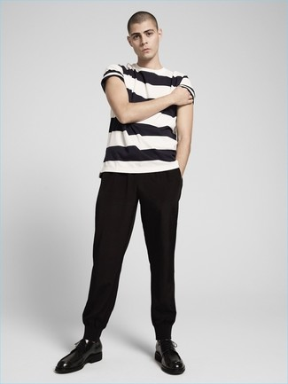 How to Wear Black Sweatpants In Hot Weather Casually For Men: This pairing of a white and black horizontal striped crew-neck t-shirt and black sweatpants will cement your skills in men's fashion even on lazy days. Feeling experimental? Shake up this look by wearing black leather derby shoes.
