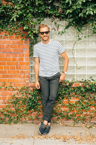 How to Wear a White and Black Horizontal Striped Crew-neck T-shirt For Men: This relaxed pairing of a white and black horizontal striped crew-neck t-shirt and charcoal chinos is a surefire option when you need to look laid-back and cool in a flash. To add some extra zing to this look, complement your ensemble with navy leather derby shoes.