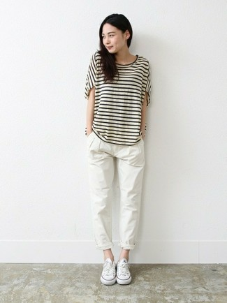 How to Wear White Chinos For Women: A white and black horizontal striped crew-neck t-shirt and white chinos are amazing items to add to your current casual repertoire. White canvas low top sneakers tie the getup together.