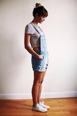 Stay stylish on busy days in a white and black striped cropped top and baby blue overall shorts. Finish off your look with white low top sneakers.