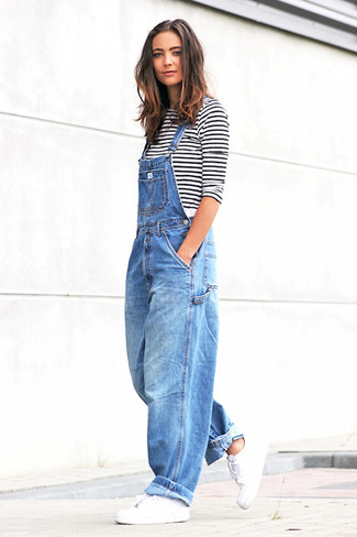 How to Wear a White and Black Horizontal Striped Long Sleeve T-shirt For Women: Opt for a white and black horizontal striped long sleeve t-shirt and blue denim overalls if you wish to look edgy and casual without much effort. White leather low top sneakers will pull the whole thing together.