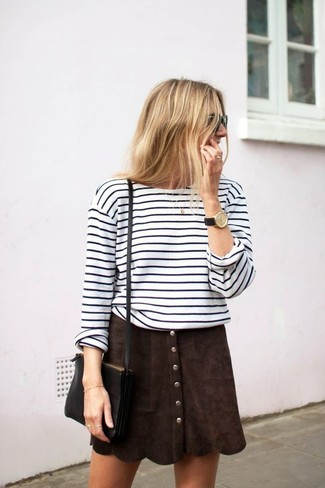 Consider pairing a white and black horizontal striped long sleeve t-shirt with a button skirt for a casual level of dress. Rest assured, this look will keep you comfy as well as looking cute in this weird transition weather.
