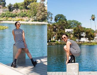 How to wear: white and black horizontal striped shift dress, black chunky leather ankle boots, beige sunglasses