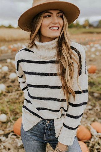How to wear: white and black horizontal striped turtleneck, blue skinny jeans, khaki wool hat