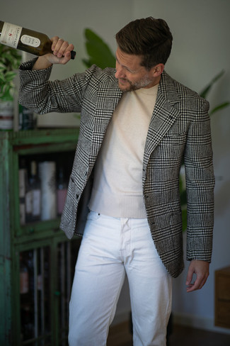 Beige Crew-neck Sweater Spring Outfits For Men: Master the casually stylish getup by wearing a beige crew-neck sweater and white jeans. This ensemble is super functional and will help you out in weird transition weather.
