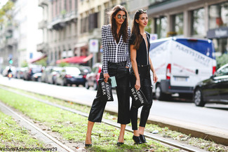 Pair a monochrome houndstooth long sleeve blouse with black culottes for a refined yet off-duty ensemble. Take a classic approach with the footwear and choose a pair of black leather pumps.