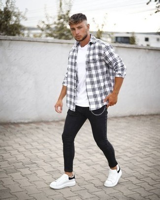 How to Wear Black Skinny Jeans For Men: A white and black plaid long sleeve shirt and black skinny jeans are a casual street style pairing that every modern guy should have in his menswear collection. On the fence about how to finish your outfit? Round off with white and black leather low top sneakers to lift it up.