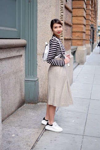 How to wear: white and black horizontal striped sequin long sleeve t-shirt, beige pleated midi skirt, white and black leather low top sneakers, white leather backpack