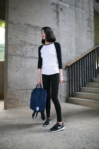 How to wear: white and black long sleeve t-shirt, black skinny jeans, black and white athletic shoes, navy backpack
