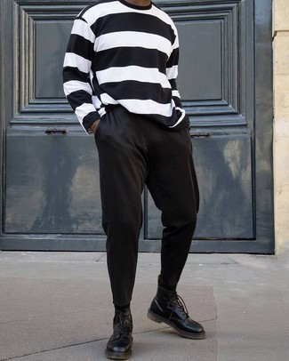 Black Sweatpants Outfits For Men: The formula for casual menswear style? A white and black horizontal striped long sleeve t-shirt with black sweatpants. Play down the casualness of your getup with black leather casual boots.