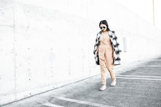 This combo of a white and black plaid coat and a beige jumpsuit is a safe bet for an effortlessly cool look. White leather flat sandals will add a new dimension to an otherwise classic look.