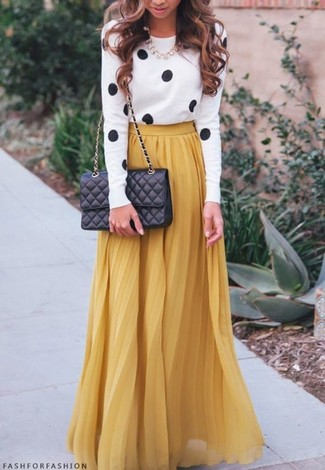 Try teaming a white and black crew-neck jumper with a mustard pleated maxi skirt and you'll look like a total babe.