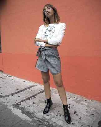 How to wear: white and black print crew-neck sweater, grey plaid mini skirt, black leather lace-up ankle boots