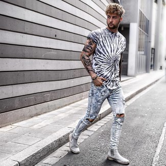 Silver Chelsea Boots Outfits For Men: One of the coolest ways for a man to style out a white and black print crew-neck t-shirt is to pair it with light blue ripped skinny jeans for a casual ensemble. If you wish to easily kick up your look with a pair of shoes, complement this outfit with silver chelsea boots.