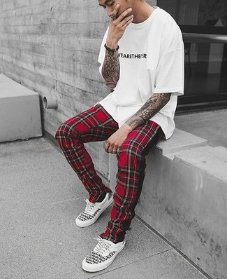 How to wear: white and black print crew-neck t-shirt, red plaid sweatpants, white and black low top sneakers