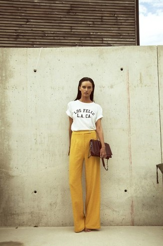 If you're facing a sartorial situation where comfort is prized, reach for a white and black print crew-neck t-shirt and yellow wide leg pants. There are many ways to look cool and survive the heatwave, and that's one of them.
