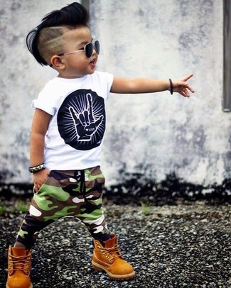 A white and black print t-shirt and olive camouflage sweatpants are a great kid outfit formula to have in your arsenal. Mustard boots are a nice choice to complete this outfit.