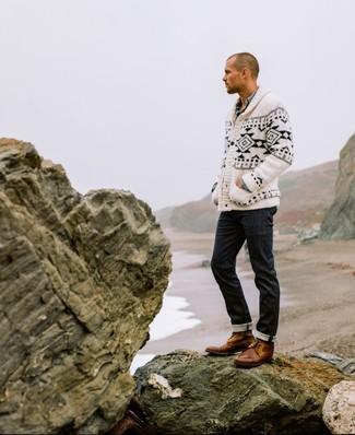 How to wear: white and black fair isle shawl cardigan, light blue chambray long sleeve shirt, black jeans, brown leather casual boots