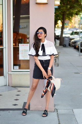 Reach for a white and black short sleeve blouse and a black denim mini skirt to achieve a chic look. Rocking a pair of Vince Camuto Vestata Leather Peep Toe Mule is an easy way to add extra flair to your look. This outfit is basically a lesson in how to dress for hot summer weather.